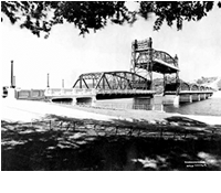 A picture of the St Croix river and historic bridge.